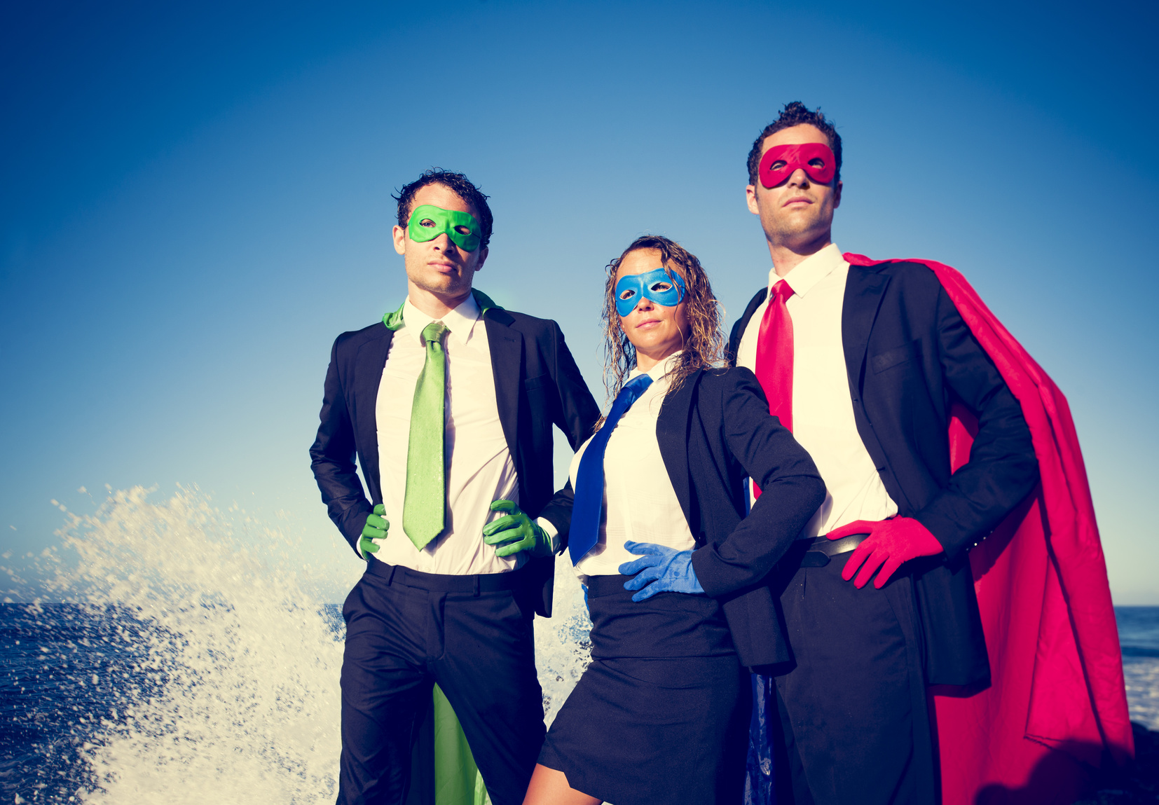 Business superheroes facing storm.