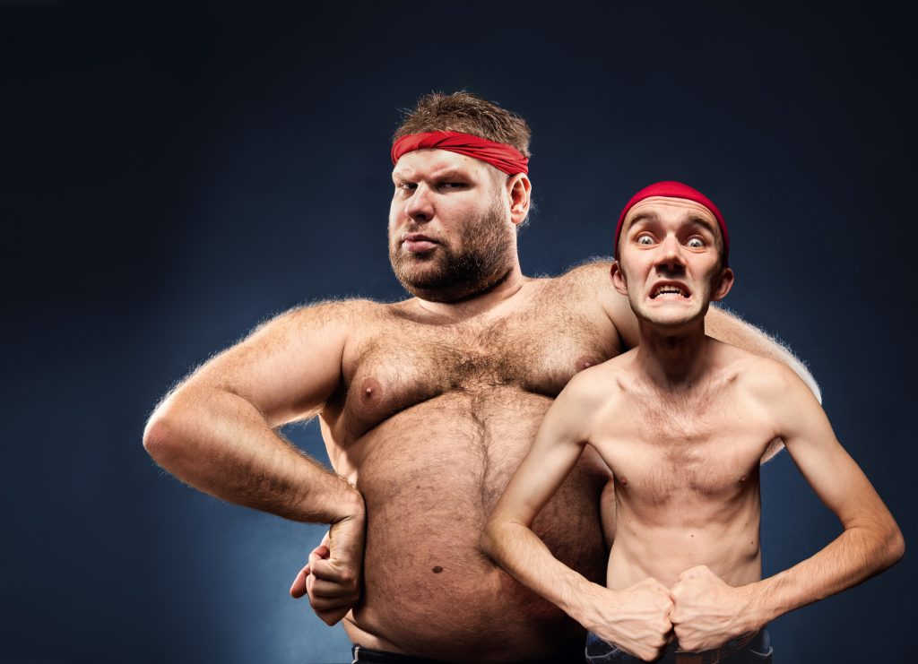 Funny fat and thin body builders show their muscles